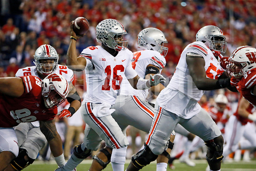 Ohio State Buckeyes quarterback J.T. Barrett (16) scrambles out of the pocket during the second quarter of the Big Ten championship football game against the Wisconsin Badgers at Lucas Oil Stadium in Indianapolis on Dec. 2, 2017. [Adam Cairns / Dispatch]