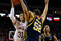 January 9, 2014: Shavon Shields (31) of the Nebraska Cornhuskers drives into Jordan Morgan (52) of the Michigan Wolverines at the Pinnacle Bank Arena, Lincoln, NE. Michigan defeated Nebraska 71 to 70.