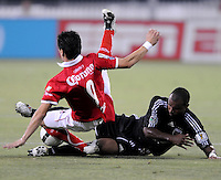 DC United defender Julius James (2) collides with Toluca FC forward Hector Mancilla (9)    Toluca FC defeated DC United 3-1in the Concacaf Champions League tournament,at RFK Stadium Wednesday, August 26  2009.