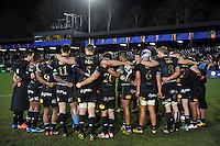 The Bath Rugby team huddle together after the match. European Rugby Champions Cup match, between Bath Rugby and Wasps on December 19, 2015 at the Recreation Ground in Bath, England. Photo by: Patrick Khachfe / Onside Images