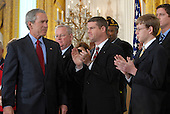 United States President George W. Bush departs after calling on Congress to pass an Iraq War spending bill with no timetable for withdrawal in the East Room of the White House in Washington, D.C. on April 16, 2007. Behind Bush are veterans and family members of service personnel.     <br /> Credit: Roger L. Wollenberg / Pool via CNP