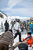 USA, California, Mammoth, several skiers and snowboarders rest at the bottom of the chairlift at Mammoth Ski Resort