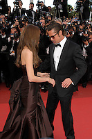 ANGELINA JOLIE &amp; BRAD PITT<br /> 'The Tree of Life' premiere at the Palais des Festival, 64th International Cannes Film Festival, France<br /> 16th May 2011<br /> half 3/4 length strapless silk satin brown dress gown black tux tuxedo tinted glasses sunglasses shades couple gathered goatee facial hair photographers press profile looking down side funny<br /> CAP/PL<br /> &copy;Phil Loftus/Capital Pictures /MediaPunch ***NORTH AND SOUTH AMERICAS ONLY***
