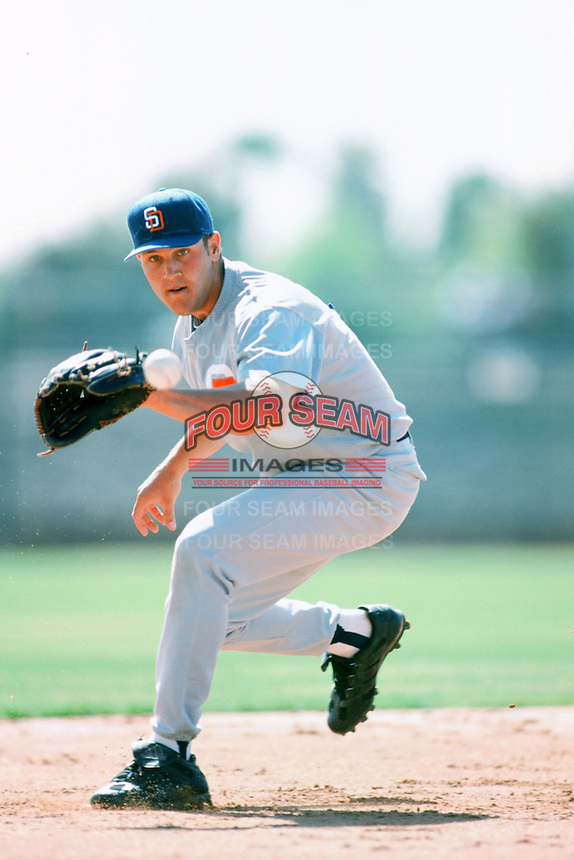 Sean Burroughs of the San Diego Padres fields a ball before a 1999 Major League Baseball Spring Training Game in Phoenix, Arizona. (Larry Goren/Four Seam Images)