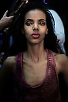 CAPE TOWN, SOUTH AFRICA - JULY 15: A model has her make up and hair done before a fashion show at the the Cape Town Fashion Week on July 15, 2011, in Cape Town, South Africa. Some of South Africa's finest designers showed their 2011 Spring and summer collections during the 3 day event. (Photo by Per-Anders Pettersson)