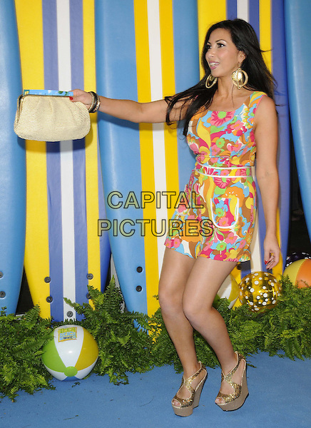 Francine Lewis<br /> The &quot;Teen Beach Movie&quot; VIP film screening, The Riverfront Cafe Bar, BFI, London, England.<br /> July 7th, 2013<br /> full length white pattern dress pink yellow blue floral print hand arm side profile beige clutch bag mouth open gold wedges platform shoes  <br /> CAP/CAN<br /> &copy;Can Nguyen/Capital Pictures