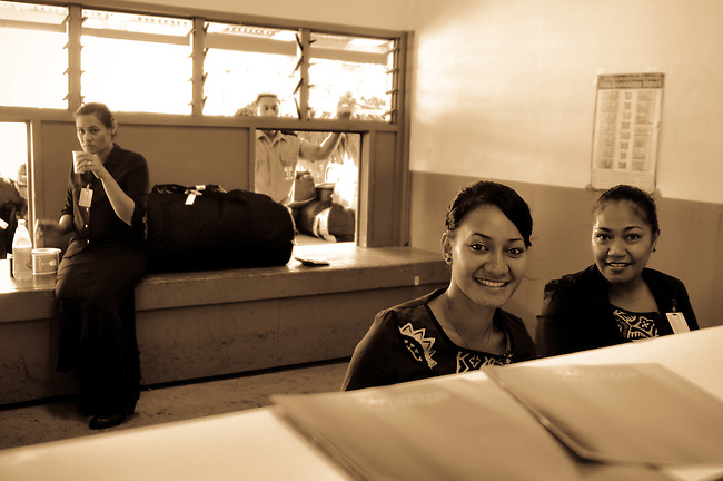 Smiling stewardess in the front desk at Tonga Taupo national airport.