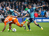 Paris Cowan-Hall of Wycombe Wanderers tackles Nathan Delfouneso of Blackpool during the Sky Bet League 2 match between Wycombe Wanderers and Blackpool at Adams Park, High Wycombe, England on the 11th March 2017. Photo by Liam McAvoy.