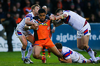 Picture by Alex Whitehead/SWpix.com - 27/04/2018 - Rugby League - Betfred Super League - Castleford Tigers v Wakefield Trinity - Mend-A-Hose Jungle, Castleford, England - Castleford's Junior Moors is tackled by Wakefield's Kyle Wood, Matty Ashurst and Craig Huby.