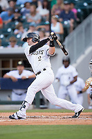 Brett Hayes (2) of the Charlotte Knights follows through on his swing against the Indianapolis Indians at BB&T BallPark on June 17, 2016 in Charlotte, North Carolina.  The Knights defeated the Indians 4-0.  (Brian Westerholt/Four Seam Images)