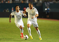 07.08.2013.Miami, Florida, USA.  Cristiano Ronaldo Dossant(7) and Marcelo Vieira (12) during the second half of the  the final of the Guinness International Champions Cup between Real madrid and Chelsea. The game was won by a score of 3-1 by Real Madrid with Ronaldo scoring a brace.