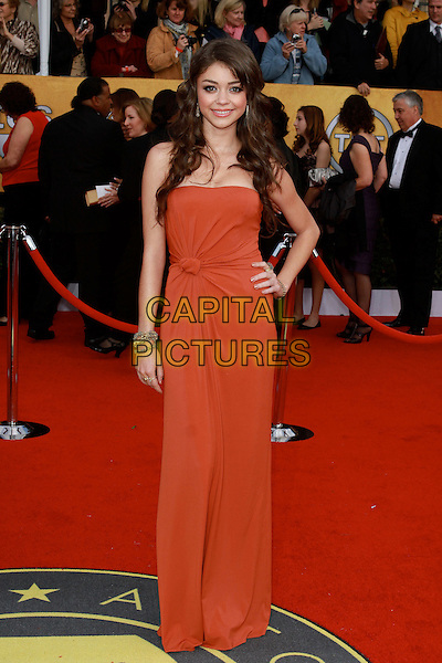 SARAH HYLAND.17th Annual Screen Actors Guild Awards held at The Shrine Auditorium, Los Angeles, California, USA..January 30th, 2011.SAG arrivals full length orange strapless knotted dress maxi hand on hip.CAP/ADM/KB.©Kevan Brooks/AdMedia/Capital Pictures.