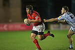 Munster centre Ian Keatley slips past Gavin Evans..Celtic League.Cardiff Blues v Munster.02.11.12.©Steve Pope