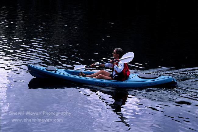 Woman kayaking on Lindsey Lake