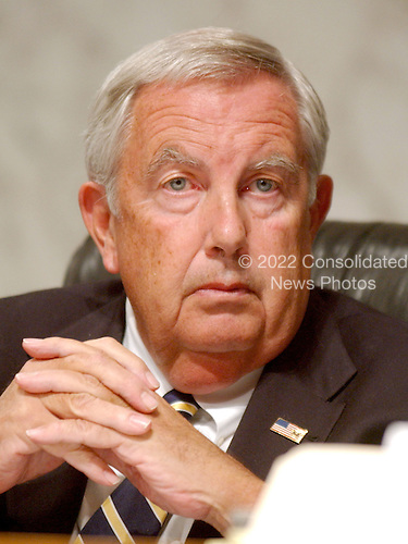 Washington, D.C. - March 23, 2004 -- The National Commission on Terrorist Attacks Upon the United States (also known as the 9-11 Commission) member Fred F. Fielding listens to Secretary Rumsfeld's testimony before the commission in Washington, D.C. on March 23, 2004.<br /> Credit: Ron Sachs / CNP<br /> [RESTRICTION: No New York Metro or other Newspapers within a 75 mile radius of New York City]