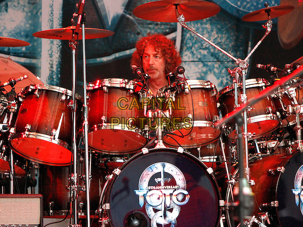 Simon Phillips<br /> Classic rockers Toto made a stop on their tour at the Chastain Park Amphitheatre, where they performed for a crowd of enthusiastic fans who braved the threat of rain to hear hits like &quot;Ninety-Nine,&quot; &quot;Roseanna&quot; and more. <br /> August 14th, 2013 <br /> on stage in concert live gig performance performing music half length drums drummer <br /> CAP/ADM/DH<br /> &copy;Dan Harr/AdMedia/Capital Pictures