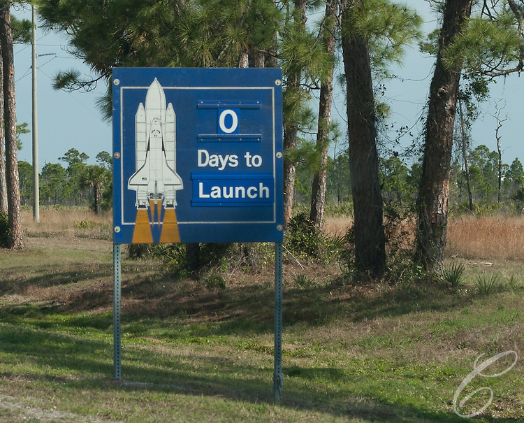 Signs greeting staff and visitors entering Kennedy Space Center announce it is launch day for the Space Shuttle Discovery on February 24, 2011.  Discovery's mission takes it to the International Space Station (ISS) to deliver the PMM module and Robonaut 2.