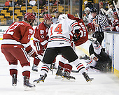 Colin Moore (Harvard - 12), Daniel Moriarty (Harvard - 11), Braden Pimm (Northeastern - 14), Brendan Rempel (Harvard - 42), Garrett Vermeersch (Northeastern - 9) - The Northeastern University Huskies defeated the Harvard University Crimson 4-0 in their Beanpot opener on Monday, February 7, 2011, at TD Garden in Boston, Massachusetts.