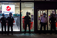 NEW YORK, NEW YORK - May 31: Police protect a CVS Pharmacy warehouse after being attacked on May 31, 2020 in New York. Protests spread across the country in at least 30 cities in the United States. USA For the death of unarmed black man George Floyd at the hands of a police officer, this is the latest death in a series of police deaths of black Americans (Photo by Pablo Monsalve / VIEWpress via Getty Images)