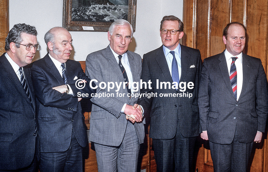 Peter Barry, Minister for Foreign Affairs, Rep of Ireland, left, is welcomed by  Tom King, UK Secretary of State for N Ireland, at the first session of the Anglo-Irish Agreement in Stormont Castle, Belfast, on 11th December 1985.  In the photo from left are: Liam Kavnagh, Minister for the Environment, Rep of Ireland, Rhodes Boyson, junior minister, N Ireland Office, Peter Barry, Tom King, Michael Noonan, Minister for Justice, Rep of Ireland. 19851201PB6.<br />