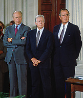 Washingtn DC., USA, September 14, 1993<br /> Former Presidents Ford, Carter, and Bush attend the NAFTA signing ceremony in the East room of the White House. Credit: Mark Reinstein/MediaPunch