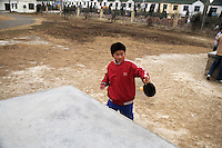 Children play ping-pong at recess in the schoolyard at Xiaoliji Middle School in Lianshui County, Jiangsu Province, China.  The Pfrang Association, a German charity based in Nanjing, China, sponsors a number of children in the school, providing money for boarding, food, clothing, school supplies, and other necessities to continue schooling.  The majority of children at this school come from poor farming families in rural Jiangsu Province, China.