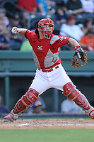 Catcher Jake Romanski (12) of the Greenville Drive in a game against the Asheville Tourists on Tuesday, July 1, 2014, at Fluor Field at the West End in Greenville, South Carolina. Asheville won, 5-2. (Tom Priddy/Four Seam Images)