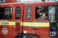 Fire engine on emergency call struggling to get through heavy traffic.