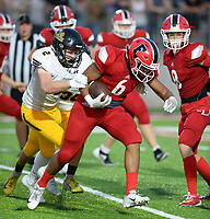 NWA Democrat-Gazette/ANDY SHUPE<br /> Farmington running back Jaden Schader (6) carries the ball Friday, Sept. 6, 2019, as he is hit by Prairie Grove defensive end Graham Guenther (2) during the first half of play at Cardinal Stadium in Farmington. Visit nwadg.com/photos to see more photographs from the game.