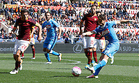 Calcio, Serie A: Roma vs Napoli. Roma, stadio Olimpico, 25 aprile 2016.<br /> Napoli&rsquo;s Dries Mertens, right, is challenged by Roma&rsquo;s Alessandro Florenzi, left, during the Italian Serie A football match between Roma and Napoli at Rome's Olympic stadium, 25 April 2016.<br /> UPDATE IMAGES PRESS/Riccardo De Luca