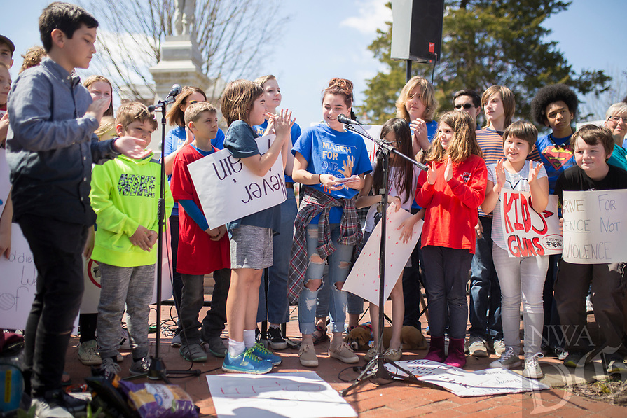 "NWA Democrat-Gazette/CHARLIE KAIJO Children from area schools demonstrate during the ""March For Our Lives"" rally, Saturday, March 24, 2018 at the Bentonville Square in Bentonville. <br /> <br /> ""March For Our Lives"" is a march against gun violence. ""[We're] just a group of kids who got together one day and wanted to make a change,"" said Taylor Gibson, 16, a student at Bentonville West High School. She is one of nine students from area high schools including Bentonville West, Bentonville High, Gravette and Haas Hall who organized the rally. The rally is in solidarity with more than 800 protests around the world according to ""March For Our Lives"" organizers"