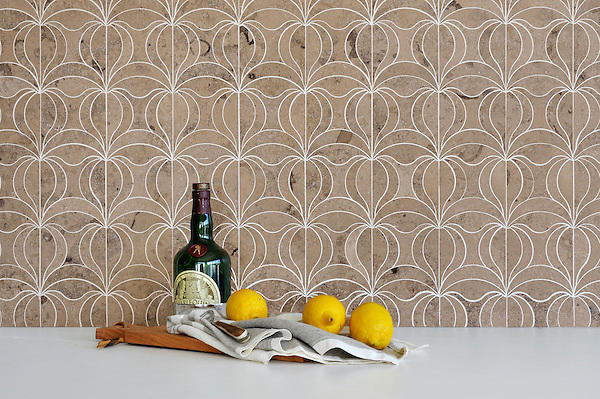 Calla, a waterjet mosaic shown in honed Jura Grey, is part of the Miraflores collection by Paul Schatz for New Ravenna.