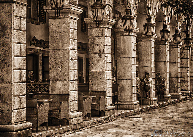 A sepia toned image of cafe on Liston Promenade in Corfu Town, Corfu Island, Greece.