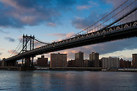 Manhattan bridge in the evening under bright pink skies