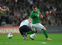 29.05.2013 London, England. Simon Cox, Republic of Ireland, in action against Michael Carrick, England, during the International Friendly between England and Republic of Ireland from Wembley Stadium.