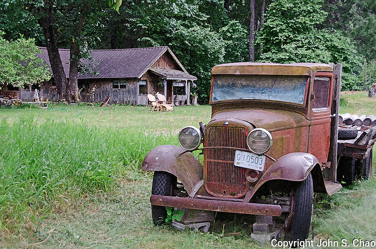 Historic Buckner Farmhouse with Truck. Image photomanipulated with a drybrush filter. Located in Stehekin, North Cascades National Park, Washington State