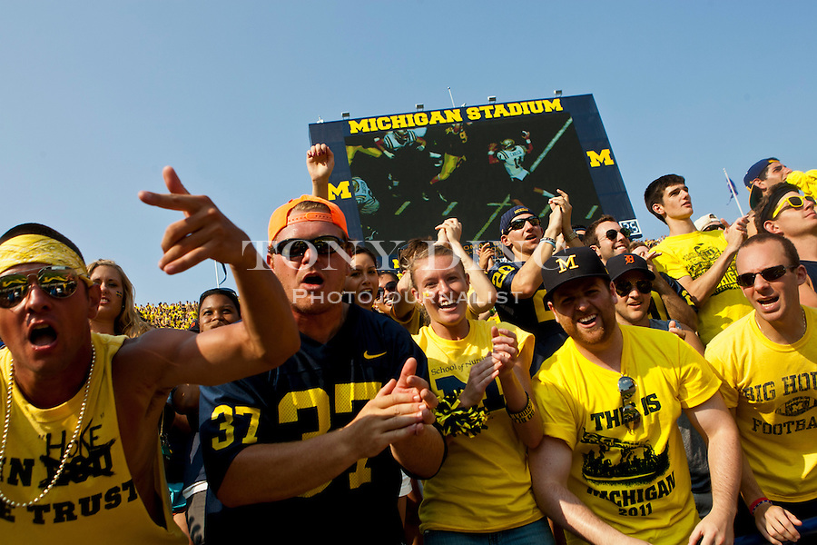 The Michigan Stadium student section provides the energy and noise during the season opener against Western Michigan, Saturday, Sept. 3, 2011 in Ann Arbor, Mich. (Tony Ding for The New York Times)