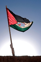 A Saharawi flag is pictured in the wilaya of Ausserd on December 13, 2003. Saharawi people have been living at the refugee camps of the Algerian desert named Hamada, or desert of the deserts, for more than 30 years now. Saharawi people have suffered the consecuences of European colonialism and the war against occupation by Moroccan forces. Polisario and Moroccan Army are in conflict since 1975 when Hassan II, Moroccan King in 1975, sent more than 250.000 civilians and soldiers to colonize the Western Sahara when Spain left the country. Since 1991 they are in a peace process without any outcome so far. (Ander Gillenea / Bostok Photo)