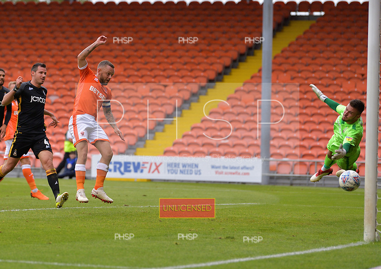 08/09/2018 Sky Bet League 1 Blackpool v Bradford City<br /> <br /> Jay Spearing follows up to shoot past Richard O'Donnell for Blackpool\s second goal