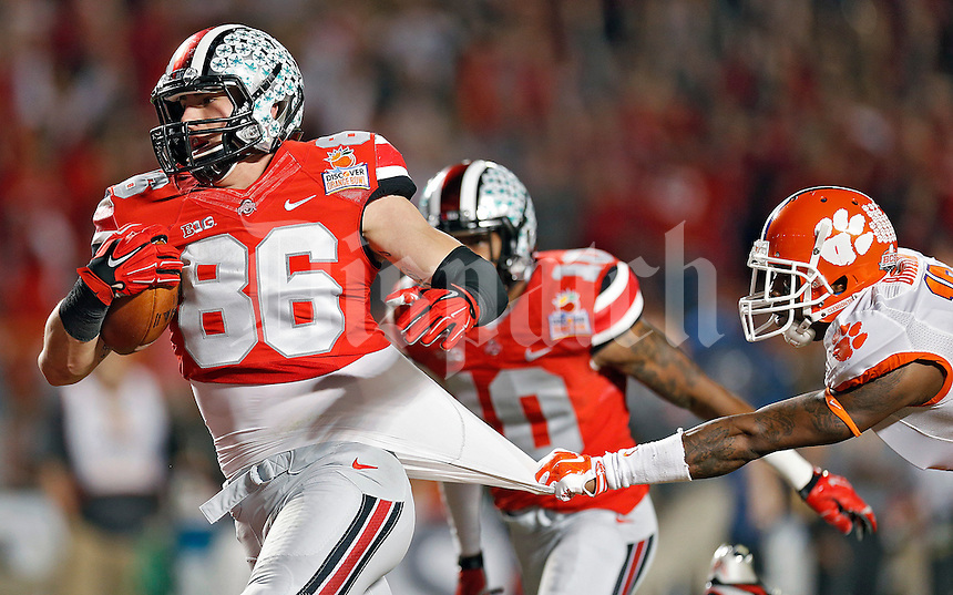 Ohio State Buckeyes tight end Jeff Heuerman (86) gets past Clemson Tigers defensive back Bashaud Breeland (17) for a touchdown catch in the 2nd quarter of their game against Clemson Tigers in the Discover Orange Bowl at Sun Life Stadium in Miami Gardens, Florida on January 3, 2014.(Dispatch photo by Kyle Robertson)