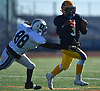 Christian Fredericks #3 of Conference II/III (Lawrence) looks to pick up yards on a quarterback keep as Ethan Ceriano #88 of Conference I/IV (Division Avenue) closes in on him during the Nassau County Senior Bowl at Mitchel Athletic Complex in Uniondale on Thursday, Nov. 22, 2018.