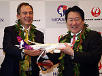 September 26, 2017, Tokyo, Japan - Hawaiian Airlines president Mark Dunkerley (L) and Japan Airlines (JAL) president Yoshiharu Uek display a Hawaiian Airline' model plane as they announce to agree a comprehensive partnership at the JAL headquarters in Tokyo on Thursday, September 26, 2017. Their agreement provides for extensive code sharing, lounge access and frequent flyer program reciprocity.   (Photo by Yoshio Tsunoda/AFLO) LWX -ytd