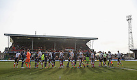 The teams shake hands during the Sky Bet League 2 match between Grimsby Town and Wycombe Wanderers at Blundell Park, Cleethorpes, England on 4 March 2017. Photo by Andy Rowland / PRiME Media Images.