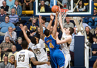 David Kravish of California tries to block the ball during the game against UCLA at Haas Pavilion in Berkeley, California on February 14th, 2013.   California defeated UCLA, 77-63.