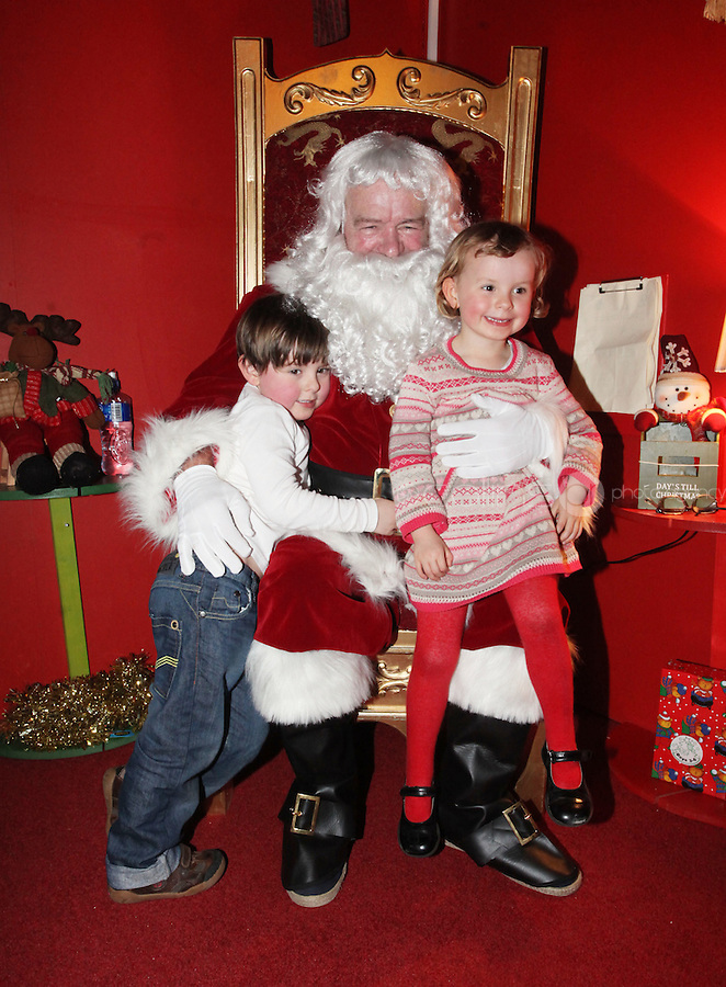 ****NO FEE PIC ******.19/11/2011.(L to r).Hugh Prenderville (5).Geniveve Prenderville (3) both from Monkstown .at the opening of Santa's Playland in The Ambassador Theatre,Dublin.One of this Christmas' biggest events is coming!  Santa's Playland takes up residence at The Ambassador Theatre in preparation for this year's festive season.  The spectacular event opens on Saturday 19 November and runs until Friday 23 December. Santa's Playland will see children transported to a magical Christmas paradise.On entering Santa's Playland children will be treated to a special Christmas play time.  The Play Area is full of Christmas treats with bouncy castles, slides and Christmas displays..Photo: Gareth Chaney Collins