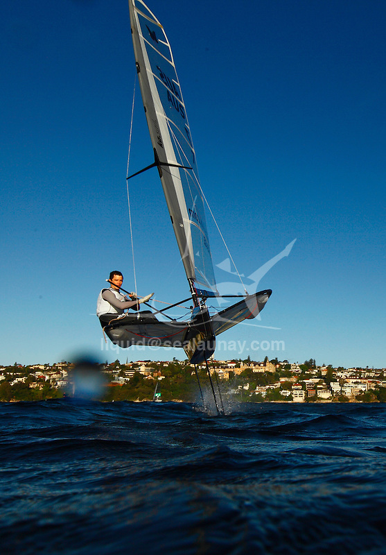 "Scott Babbage and Matt Day in a training session on his Moth Mach 2 in Sydney Harbour, Single-handed sailing dinghy with hydro-foils..Enter McConaghy Boats, builders of the ""Fastest Boats on the Planet"". McConaghy Boats understand strong, light and fast and in no time at all McConaghy partnered with McDougall and began to build the next generation of foiling moths. Drawing upon the two names McDougall / McConaghy and acknowledging the name of the 2nd moth ever built by founder John McConaghy, they formed Mach 2 Boats Pty Ltd.."