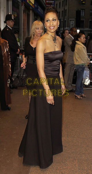 """NAOMI TAYLOR.""""Rollin' With The Nines"""" - UK premiere at the Odeon Leicester Square, London, UK..April 19th, 2006.Ref: CAN.full length black satin strapless dress .www.capitalpictures.com.sales@capitalpictures.com.©Capital Pictures"""