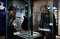 SAITAMA - DEC. 5: Museum visitor, Matthias Kluckert, and his girlfriend, Yuko, looking at one of John Lennons's guitars on display at the John Lennon Museum. (Photo by Alfie Goodrich/Nippon News)