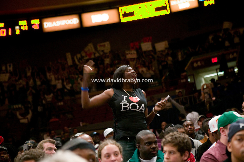 A schoolfriend (C) of Eric Boateng (not pictured) wearing a specially designed tshirt roots for him during the Jordan Classic game at Madison Square Garden in New York City, United States, 16 April 2005.