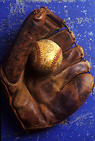 Old baseball mitt and ball.
